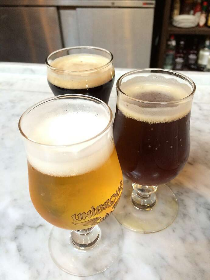 Taster glasses of the Third Man Belgian trifel, Red Headed Stranger ale and Jamison's Station porter at Brasserie Saint James in Reno. Photo: Spud Hilton, The Chronicle
