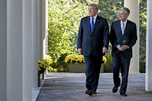 President Donald Trump, left, and Jerome Powell, Trump's nominee as chairman of the Federal Reserve, walk out to a nomination announcement in the Rose Garden of the White House on Nov. 2, 2017.