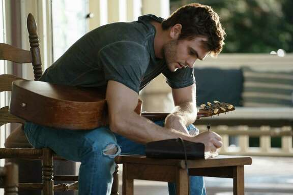 "Alex Roe's character, Liam Page, is struck by songwriting inspiration in ""Forever My Girl."""