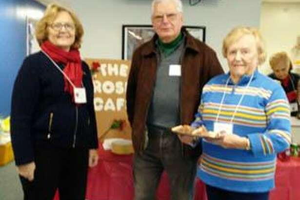 The Woman's Club of Danbury/New Fairfield, which has members from the Greater New Milford area, recently participated in its annual poinsettia sale. Four thousand poinsettias arrived at the PAL Building in Danbury Nov. 28 for the club's 20th annual project. The plants were sold by members as the club's only fundraiser. The sale raised approximately $20,000, which is given back to local charities within the greater Danbury area, including scholarships to the six local high schools. Above, from left to right, Linda Jowdy, Mike Chulkovs and Alice Flynn of New Milford take a break during the poinsettia drop-off.