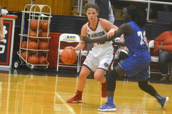 Plainview's Jesse Long tries to dribble past Palo Duro's Maren Mou in a game earlier this season. Long scored eight points in a District 3-5A game at Palo Duro Tuesday night, but Mou made a free throw with 17 seconds left which proved to be the difference in a 42-41 loss for the Lady Bulldogs.