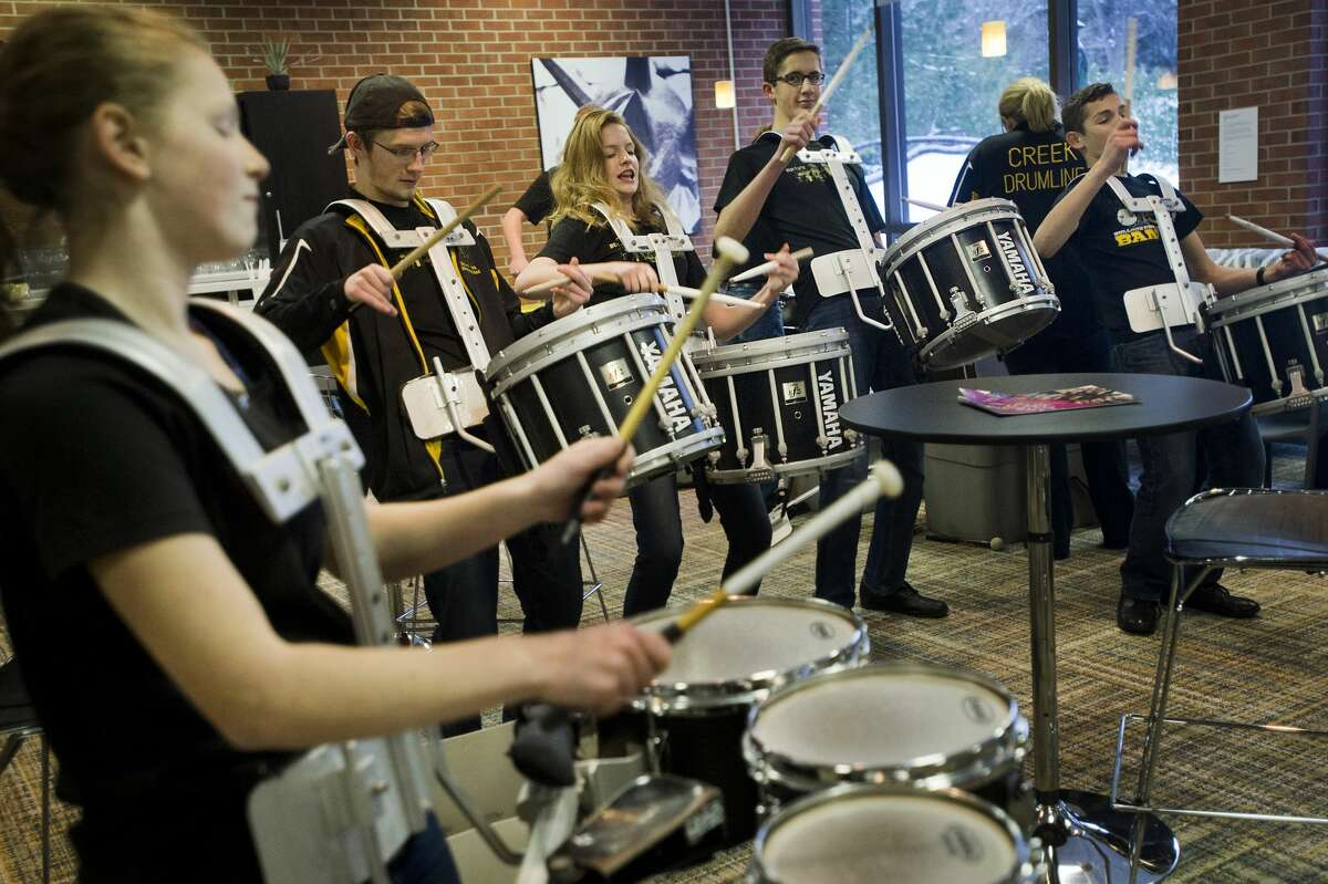 Members of the Bullock Creek High School drumline practice before playing a handful of songs to greet members of the Midland 100 Club as they arrived on Tuesday, Jan. 16, 2018 at the Midland Center for the Arts for a meeting of the philanthropy group. (Katy Kildee/kkildee@mdn.net)