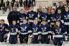 The Northwest Icehawks' PeeWee B team competed and won the Jingle Bell Tournament in Marlborough, Mass, Jan. 1. The team is shown above, from left to right, in front, Ryan Manka, Tanner Johnson, Sean Hoyt, Nicholas Dorn, Zachary Kappus, Kerstin Ambruso, and in back, coach Seth Dayton, Zachary Thompson, Roman Quinn, Coach George Kappus, Ronan McKay, Trevor Sweet, Avery Dayton, Coach Mike Sweet and Grace King.