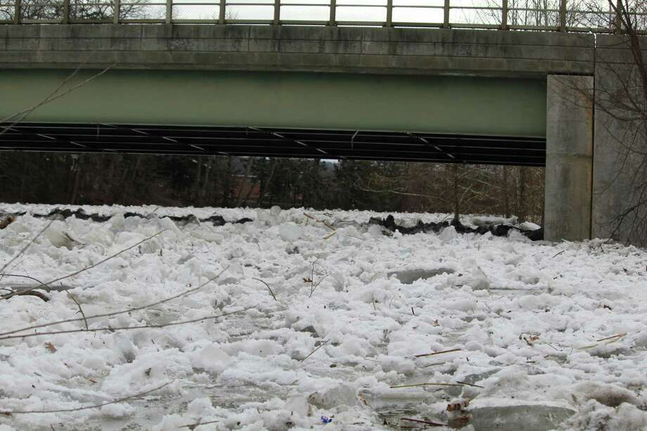 A milelong ice dam formed near downtown Kent over the weekend, flooding homes and forcing the Kent School, a private boarding school, to close for the week. Photo: Barry Lytton / Hearst Connecticut Media / Connecticut Post