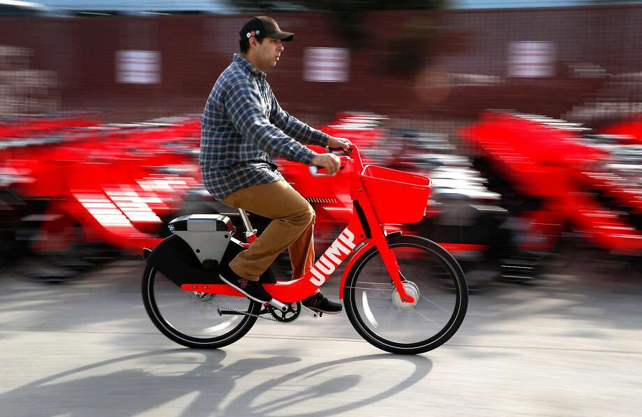 Gavin Callies test rides a Jump e-assist bicycle after final assembly in San Francisco on Wednesday. Uber is acquiring Jump, the first company to provide stationless bike sharing in San Francisco. Photo: Paul Chinn / The Chronicle