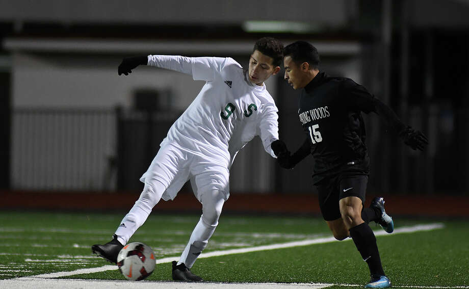 Spring miidfielder Joshue Vaca (9) shows off some fancy footwork against Spring Woods junior midfielder Michael Burger (15) during their match at Leonard George Stadium on January 12, 2018. (Photo by Jerry Baker/Freelance) Photo: Jerry Baker, Freelance / Freelance