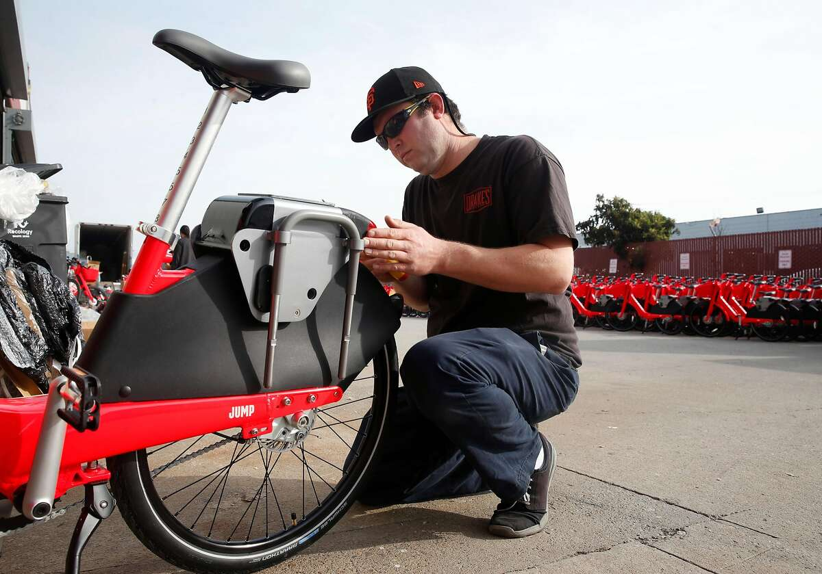 Bret Carmody completes the assembly of a Jump e-assist bicycle in San Francisco, Calif. on Wednesday, Jan. 17, 2018. Jump is deploying 250 of the bike-share electric bicycles on the streets of the city Thursday and have plans to add another 250 to the fleet later in the year.