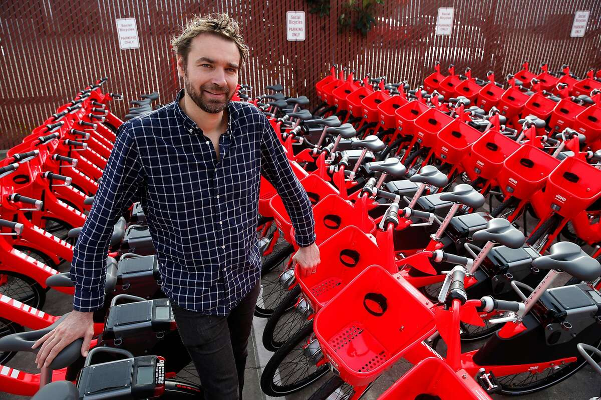 Jump Bikes founder and CEO Ryan Rzepecki is seen with e-assist bicycles that are ready to roll in San Francisco, Calif. on Wednesday, Jan. 17, 2018. Jump is deploying 250 of the bike-share electric bicycles on the streets of the city Thursday and have plans to add another 250 to the fleet later in the year.