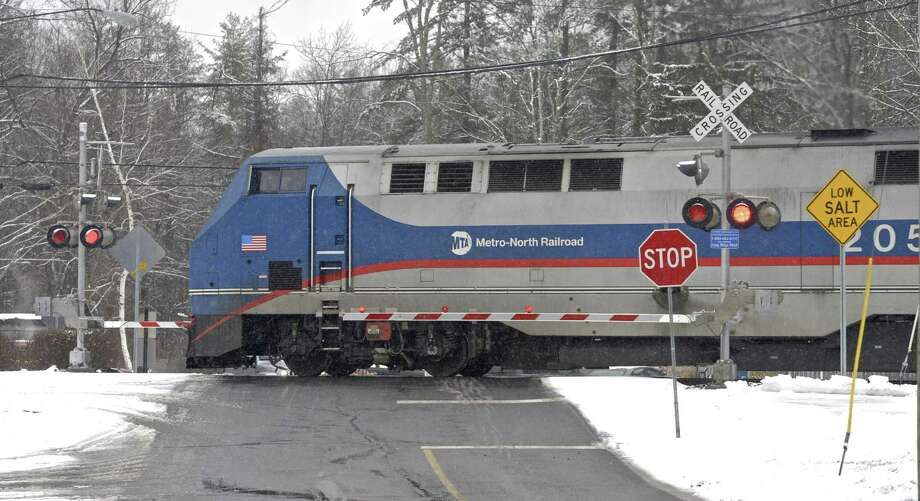 A Metro North Danbury Line train enters the Long Ridge Road train crossing on Wednesday afternoon. The state is finishing up designs on a project that aims to improve the Long Ridge Road train crossing in Redding, Conn. Wednesday, January 17, 2018. Photo: H John Voorhees III / Hearst Connecticut Media / The News-Times