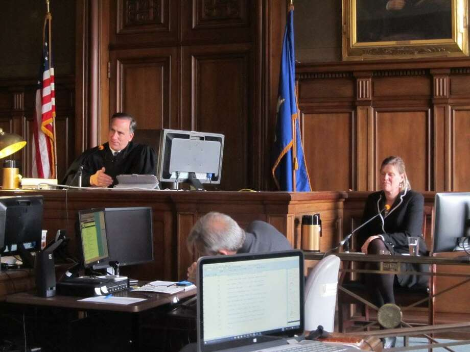 Hartford Superior Court Judge Thomas Moukawsher listens to an attorney for the plaintiffs question Sharon Locke, at right, about her experiences as a district administrator in New Britain Public Schools. Locke now serves as the superintendent in Naugatuck. Photo: Contributed Photo / Connecticut Post