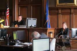 Hartford Superior Court Judge Thomas Moukawsher listens to an attorney for the plaintiffs question Sharon Locke, at right, about her experiences as a district administrator in New Britain Public Schools. Locke now serves as the superintendent in Naugatuck.