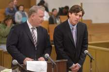 Darien High School student Brian Minicus, right, appears with his attorney Stephan Seeger Wednesday December 6, 2017, in Norwalk Superior Court in Norwalk, Conn. Two Darien teens were charged with the assault of a New Canaan minor. Brian Minicus, 18, and Jack Joyce, 18, turned themselves into New Canaan police on the night before the Turkey Bowl football game between Darien and New Canaan. Joyce was charged with disorderly conduct and interfering with an officer and Minicus was charged with third-degree assault and second-degree unlawful restraint after the two were allegedly involved in an altercation where a New Canaan teen was beaten up.