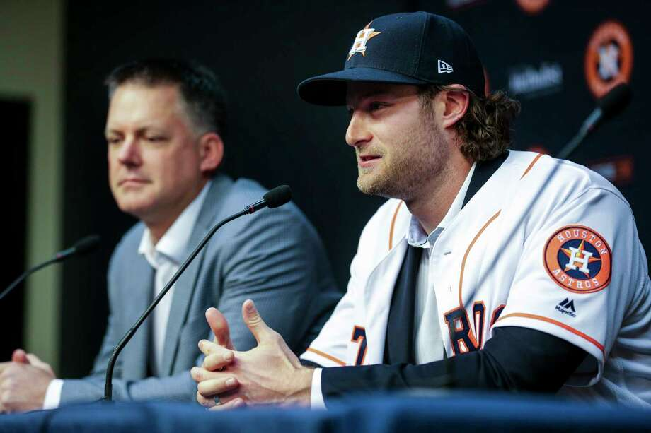 Houston Astros newly acquired pitcher Gerrit Cole, right, speaks at a press conference after being introduced at Minute Maid Park Wednesday, Jan. 17, 2018 in Houston. ( Michael Ciaglo / Houston Chronicle) Photo: Michael Ciaglo, Houston Chronicle / Michael Ciaglo