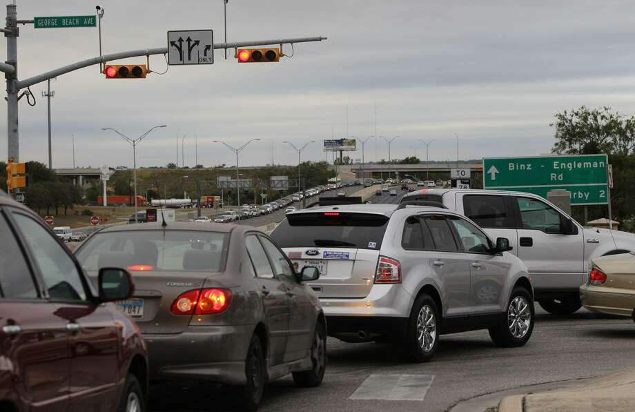 Traffic at the George Beach entrance to Brooke Army Medical Center is seen in this 2011 file photo. Tens of thousands of civilian workers at Joint Base San Antonio's three installations could be furloughed if a government shutdown occurs. JOHN DAVENPORT/jdavenport@express-news.net Photo: JOHN DAVENPORT /SAN ANTONIO EXPRESS-NEWS / SAN ANTONIO EXPRESS-NEWS (Photo can be sold to the public)