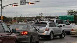 Traffic at the George Beach entrance to Brooke Army Medical Center is seen in this 2011 file photo. Tens of thousands of civilian workers at Joint Base San Antonio's three installations could be furloughed if a government shutdown occurs. JOHN DAVENPORT/jdavenport@express-news.net