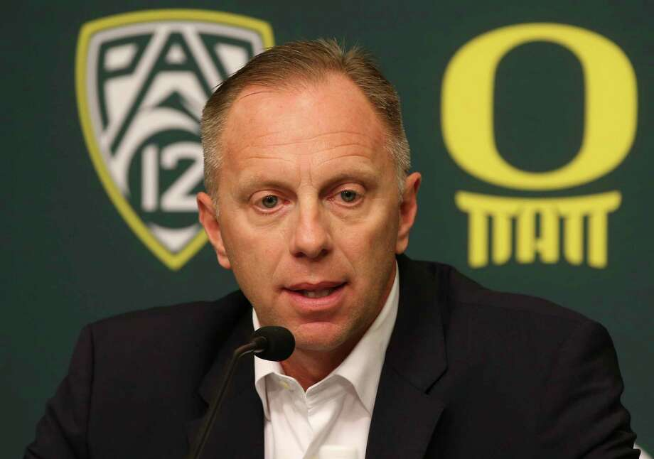 FILE - In this Nov. 29, 2016, file photo, Oregon athletic director Rob Mullens talks to the media in Eugene, Ore., after the firing NCAA college football head coach Mark Helfrich. Mullens will become the new chairman of the College Football Playoff selection committee starting next season, and three new Power Five ADs will join the 13-member panel. (Chris Pietsch/The Register-Guard via AP, File) Photo: Chris Pietsch, MBI / 2016 The Register-Guard