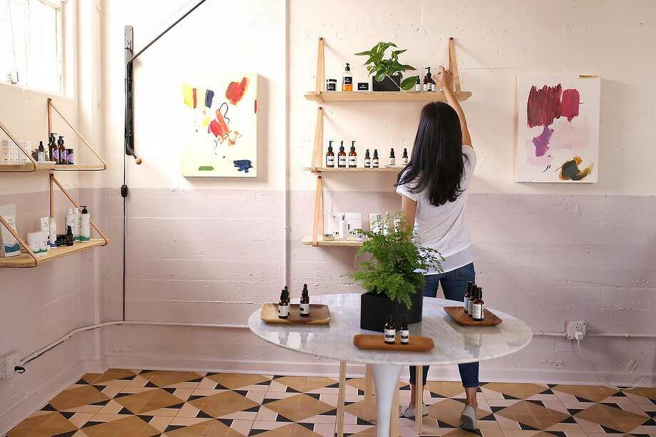 The Ayla studio is a small but mighty destination for beauty and wellness. Having just added 1,600 feet next door for office space and fulfillment, every inch of the original 500 square-foot-space is now available to learn, play with products and get treatments. Founder Dara Kennedy perfects a shelf display. Photo: Ayla Beauty