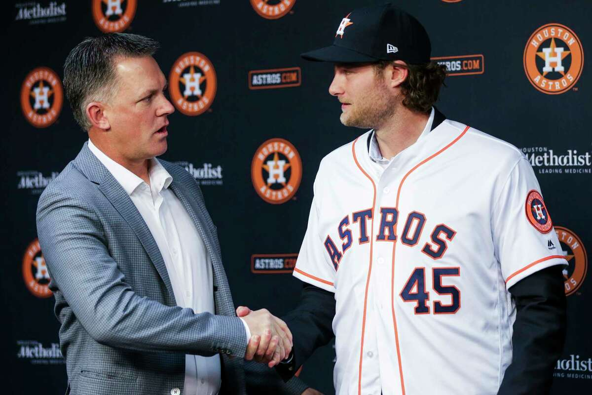Houston Astros newly acquired pitcher Gerrit Cole, right, shakes hands with manager AJ Hinch after being introduced at Minute Maid Park Wednesday, Jan. 17, 2018 in Houston.