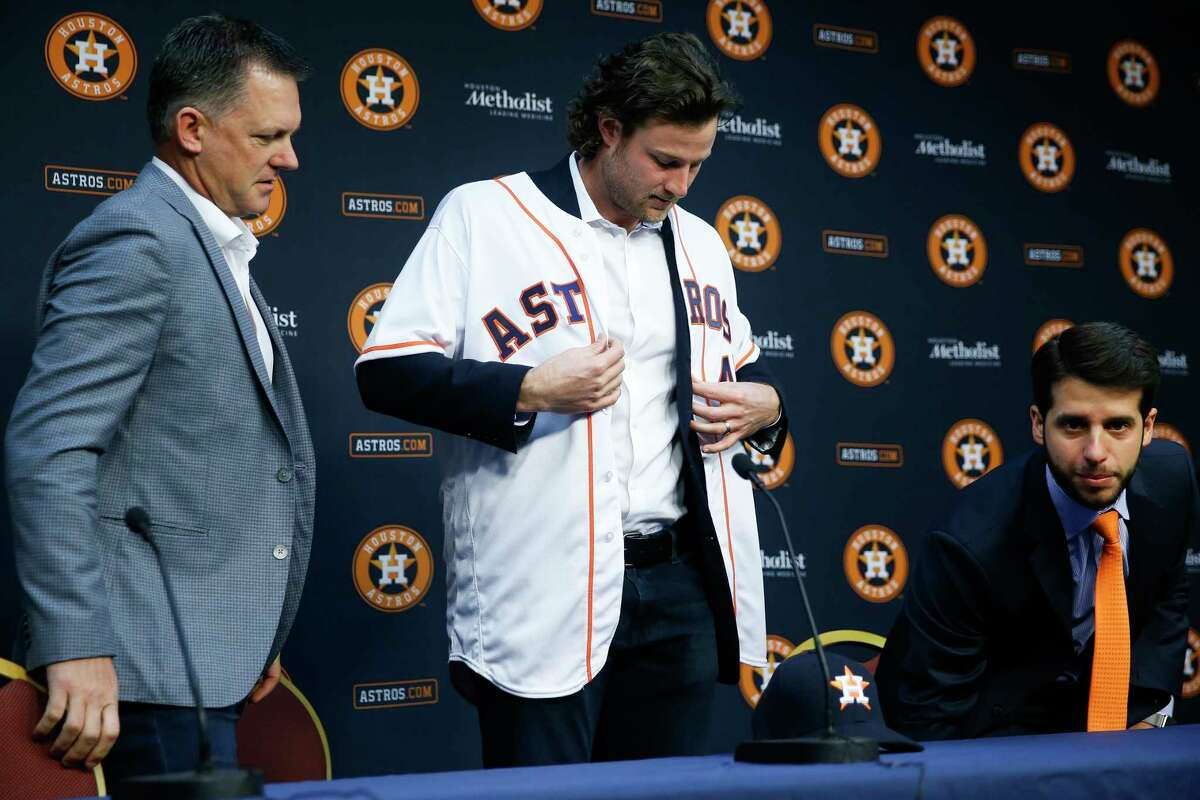 Houston Astros manager AJ Hinch, left, and Senior Director of Baseball Operations Brandon Taubman, right, introduce pitcher Gerrit Cole, who was acquired in a trade with the Pittsburgh Pirates, Wednesday, Jan. 17, 2018 in Houston.