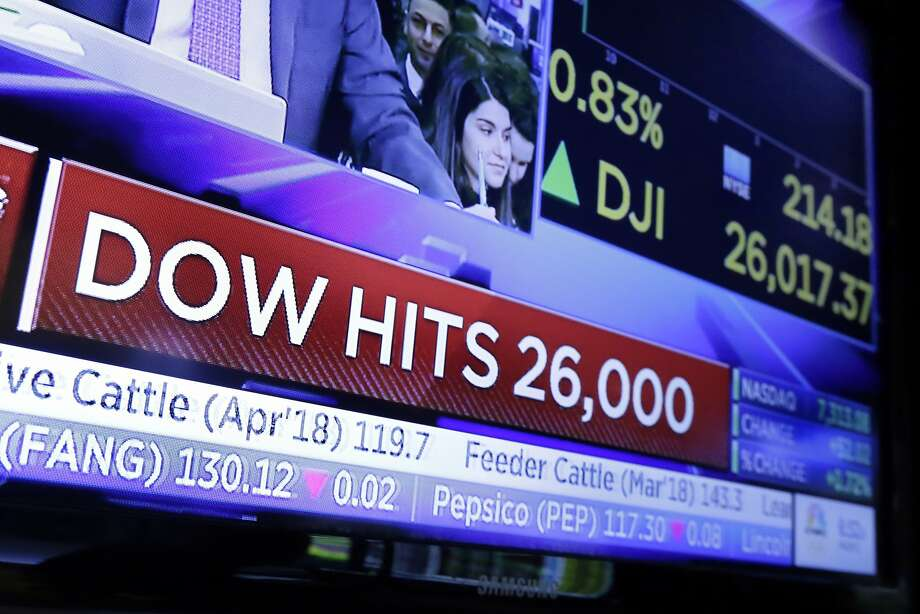 In this Tuesday, Jan. 16, 2018, file photo, a television screen on the floor of the New York Stock Exchange headlines the Dow Jones industrial average above 26,000 for the first time. President Donald Trump relentlessly congratulates himself for the healthy state of the U.S. economy, with its steady growth, low unemployment, busier factories and confident consumers. But in the year since Trump's inauguration, most economists tend to agree on this: The economy has essentially been the same sturdy one that he inherited from Barack Obama. (AP Photo/Richard Drew, File) Photo: Richard Drew, Associated Press