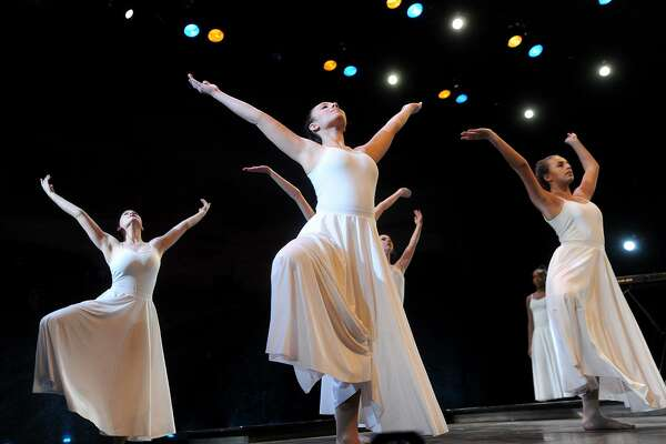 """Students from the Regional Center for the Arts perform a choreographed dance at the 12th Annual Dr. Martin Luther King, Jr. Celebration at the Westport Country Playhouse in Westport, Conn. on Sunday, January 14, 2018. The guest speaker was American University Professor Ibram Kendi, whose address was titled """"How to be an Anti-Racist""""."""