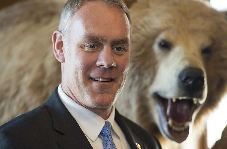 Interior Secretary Ryan Zinke at the Interior Department, where he has had a grizzly bear and other stuffed animals installed. Photo: Molly Riley, Associated Press