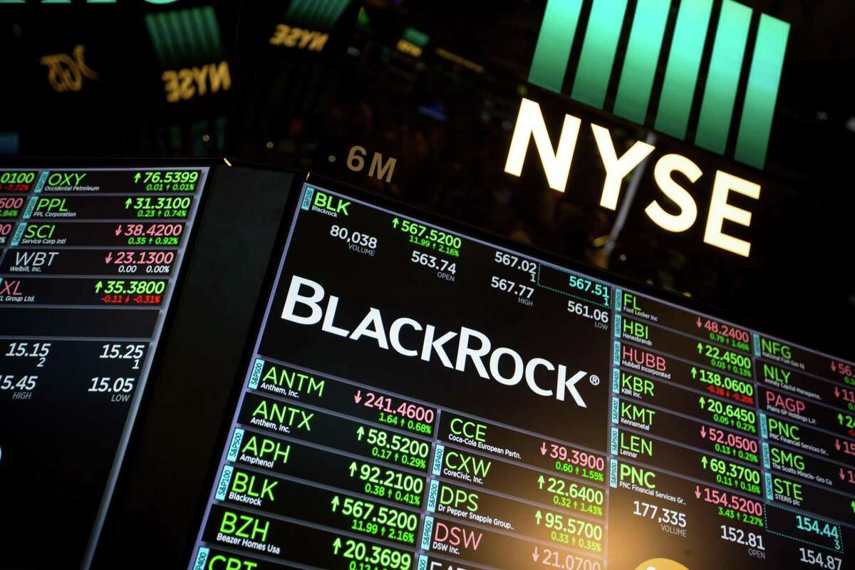 A monitor displays BlackRock Inc. signage on the floor of the New York Stock Exchange (NYSE) in New York, U.S., on Tuesday, Jan. 16, 2018. BlackRock Inc., taking a page from Silicon Valley, is offering unlimited time off. The world's largest asset manager began rolling out the perk earlier this month.