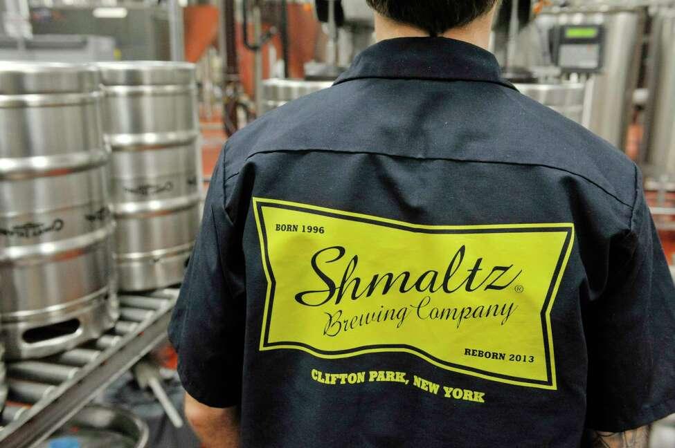 Josh Pultorak works filling kegs at the Shmaltz Brewing Company on Thursday, Nov. 13, 2014, in Clifton Park, N.Y. (Paul Buckowski / Times Union)
