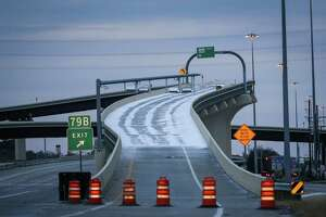 The Highway 242 flyover at I-45 is closed off due to icy conditions on Tuesday, Jan. 16, 2018, in Montgomery County.