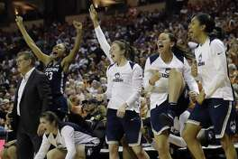 The UConn bench celebrates during the Huskies victory over Texas on Monday night in Austin, Texas. Coach Geno Auriemma would prefer that a few of his bench players force their way into the regular rotation.