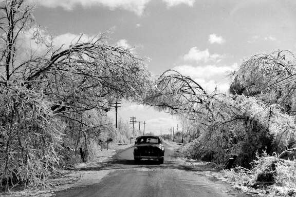 "From the Feb. 2, 1951, Houston Chronicle: ""A bough of ice-laden branches formed this unusually beautiful scene on old Post Oak Road as the sun came out Thursday afternoon.to comfort the outdoors and create a dazzling picture with a sparkle like diamonds. The scene was duplicated all over the county. The heavy ice on the branches bent them to form a complete arbor.""   ""Old Post Oak Road''? A 1953 street directory indicates that Post Oak Lane was once called that, though published materials from the 1960s note an Old Post Oak Road farther south in Bellaire."