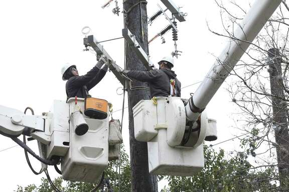 CPS Energy crews conduct work unrelated to the winter storm that gripped San Antonio Jan. 16 and 17. The storm cause a winter peak in usage across Texas' ERCOT grid Wednesday morning, breaking records set Jan. 3 and the night of Jan. 16.