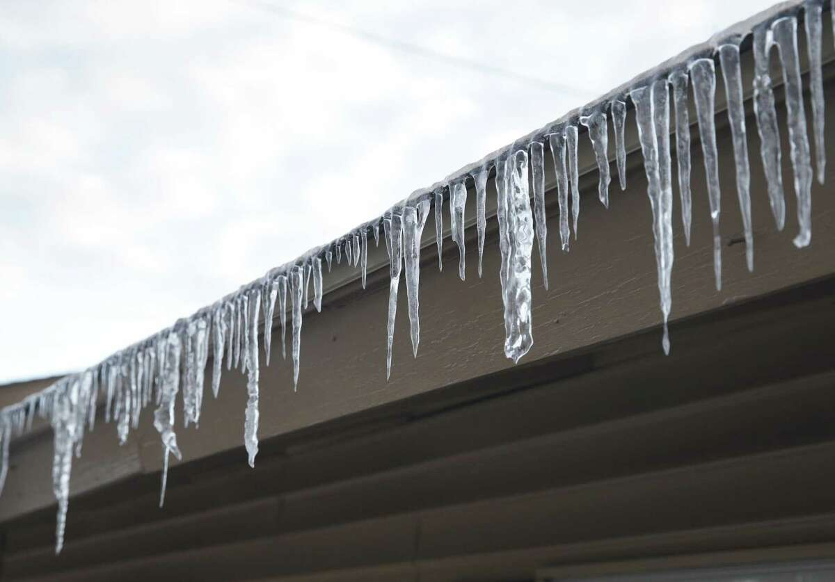 Icicles hang off an eave on San Antonio's northside Wednesday morning. Freezing temperatures across the state pushed power use to record levels Wednesday morning.
