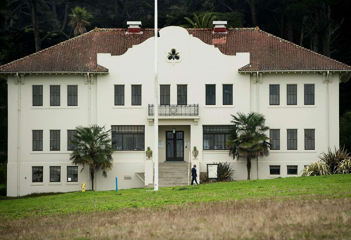 A man leaves the World Economic Forum office at Fort Scott in the Presidio on Wednesday, Jan. 17, 2018, in San Francisco. Building 1201 formerly served as headquarters for the Coast Artillery Corps Commander.