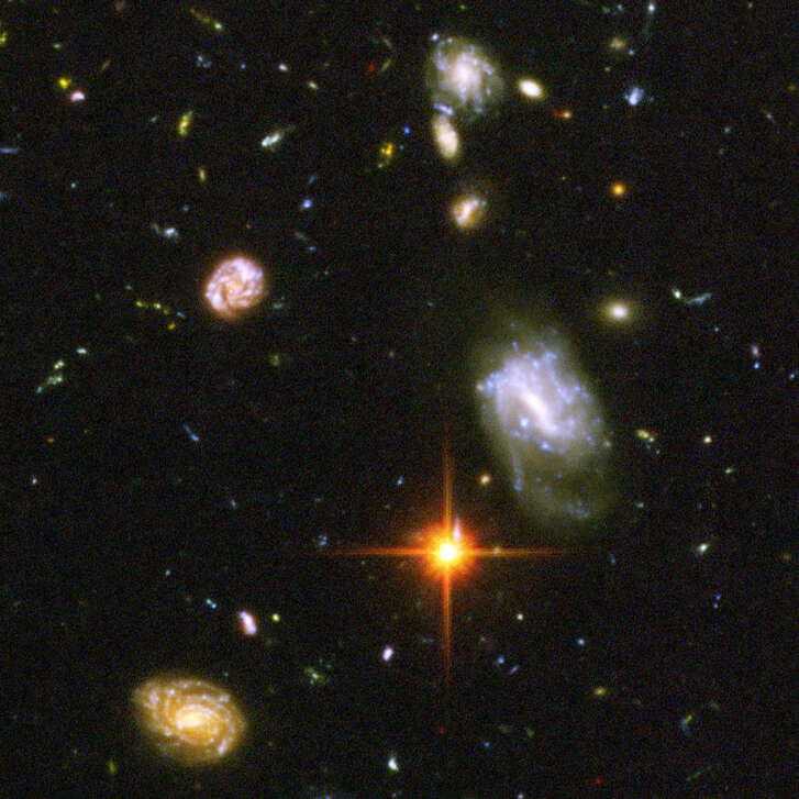 This composite photo by the Hubble Space Telescope, released Tuesday March 9, 2004  by NASA, a long-duration exposure, is the deepest-ever view of the universe, looks back to the edge of the big bang, and shows a chaotic scramble of odd galaxies smashing into each other and re-forming in bizarre shapes. The galaxies in this panel were plucked from a harvest of nearly 10,000 galaxies in the Ultra Deep Field, the deepest visible-light image of the cosmos. The image required 800 exposures taken over the course of 400 Hubble orbits around Earth. The total amount of exposure time was 11.3 days, taken between Sept. 24, 2003 and Jan. 16, 2004. (AP Photo/NASA)     HOUCHRON CAPTION (07/11/2005) SECSTAR COLOR: REACHING OUT: So far, our attempts to find life in other galaxies haven't turned up anything. However, many scientists believe that we are within a generation of making contact.