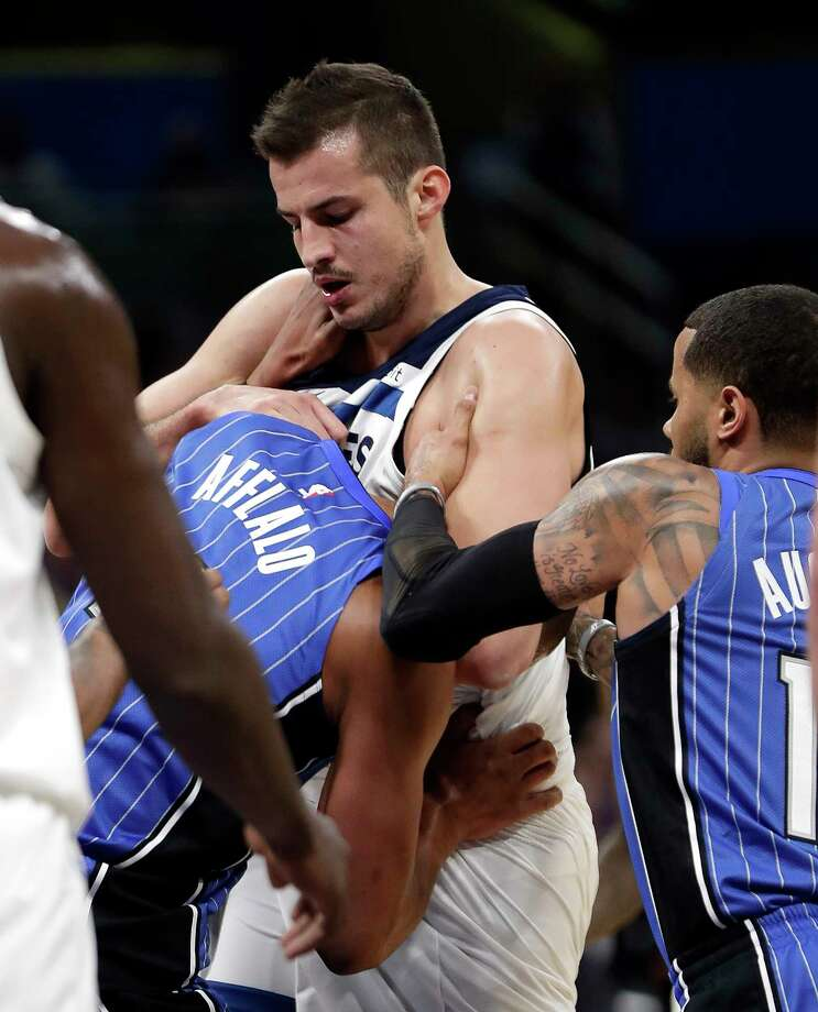 Orlando Magic's Arron Afflalo, left, gets into a fight with Minnesota Timberwolves' Nemanja Bjelica, center, as D.J. Augustin, right, comes in to help break it up during the first half of an NBA basketball game, Tuesday, Jan. 16, 2018, in Orlando, Fla. Afflalo and Bjelica were ejected from the game. (AP Photo/John Raoux) Photo: John Raoux, STF / Copyright 2018 The Associated Press. All rights reserved.