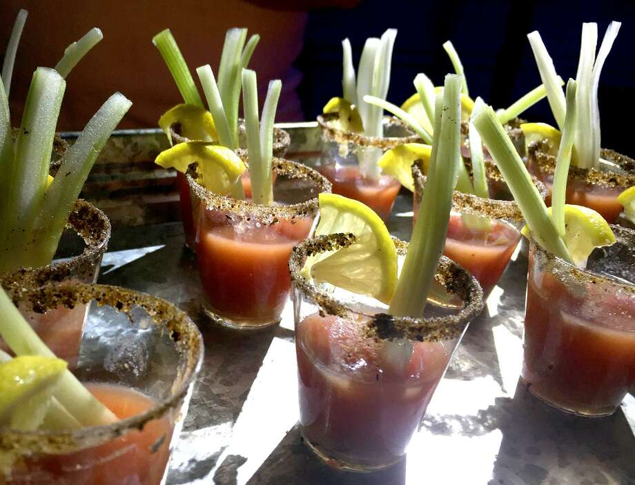 Oyster shooters made with Madge's Food Co. Fermented Bloody Mary Mix were one of several nibbles found at the San Antonio Cocktail Conference. Photo: Paul Stephen / San Antonio Express-News