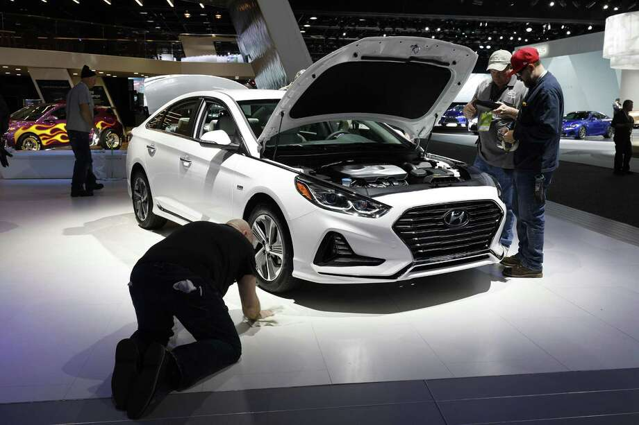 Workers prep around a Hyundai Sonata at the Hyundai 1272exhibit is shown at the 2018 North American International Auto Show January 16, 2018 in Detroit, Michigan. More than 5,100 journalists from 61 countries attend the NAIAS each year. The show opens to the public January 20th and ends January 28th. Photo: Bill Pugliano /Getty Images / 2018 Getty Images