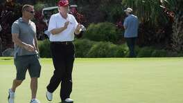 President Donald Trump strolls along the golf course with US Coast Guard Chief Warrant Officer Gene Gibson. Coast Guard service members were invited to play golf at the course in Mar-a-Lago, Florida, on Dec. 29. A reader laments what he sees as biased coverage of the president.