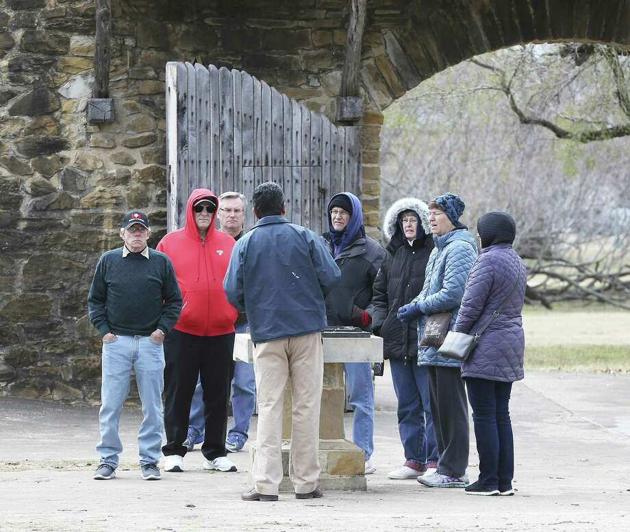 Visitors listen to a tour guide near the entrance of Mission San Jose on January 17, 2018 Photo: Tom Reel, Staff / San Antonio Express-News / 2017 SAN ANTONIO EXPRESS-NEWS