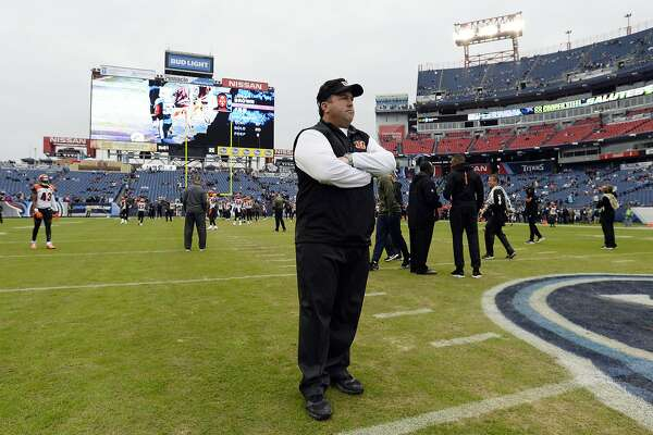 Cincinnati Bengals defensive coordinator Paul Guenther watches players warm up before an NFL football game between the Bengals and the Tennessee Titans Sunday, Nov. 12, 2017, in Nashville, Tenn. (AP Photo/Mark Zaleski)