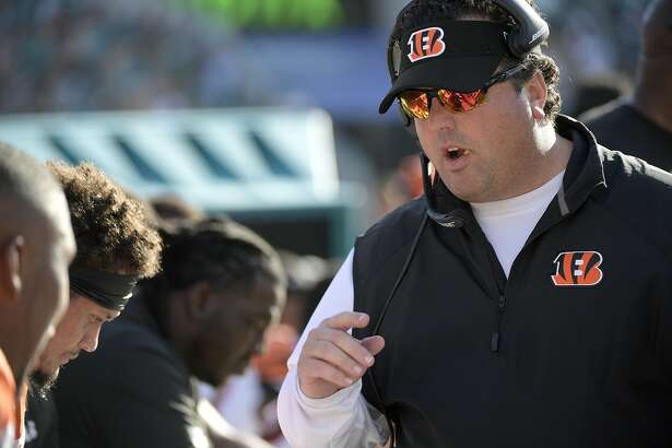 Cincinnati Bengals defensive coordinator Paul Guenther, right, talks to defensive players on the bench during the second half of an NFL football game against the Jacksonville Jaguars Sunday, Nov. 5, 2017, in Jacksonville, Fla. The Jaguars won 23-7. (AP Photo/Phelan M. Ebenhack)