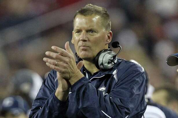 UConn football coach Randy Edsall lost offensive line coach JB Grimes Wednesday, and earlier lost offensive coordinator Rhett Lashlee.