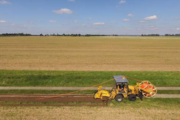HALDENSLEBEN, GERMANY - AUGUST 23: In this aerial view a worker drives a specialzed vehicle that is laying tubing used for running fiber optic cable underground during the installation of broadband infrastructure by a private company called MDDSL on August 23, 2017 near Haldensleben, Germany. The German government is subsidizing efforts to improve broadband access in rural areas. Germany faces elections on September 24 and rural development is a strongly political issue. Many rural areas in Germany, especially in the eastern parts, are facing challenges, especially due to demographics. (Photo by Sean Gallup/Getty Images)