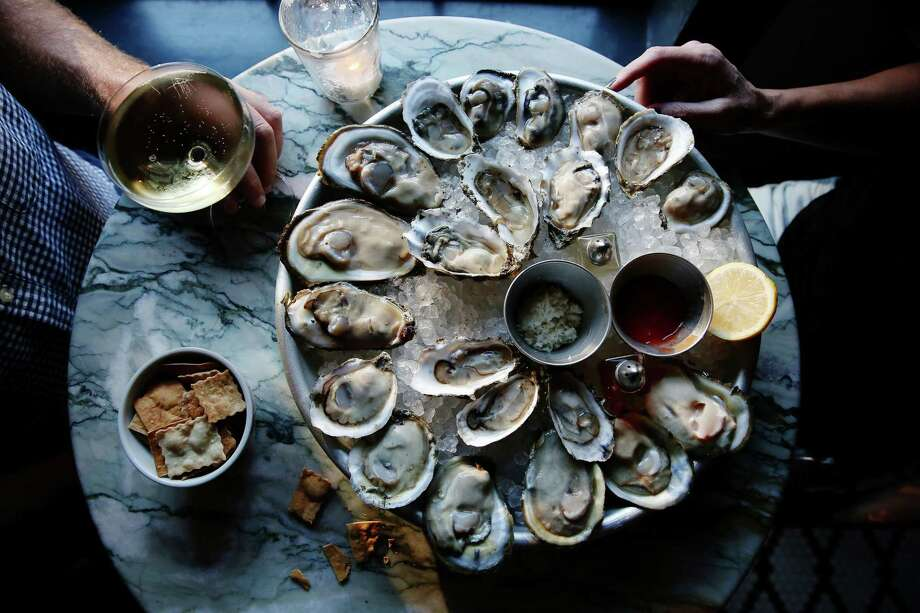 On The Bend Oyster Bar and Lounge, 123 Losoya St., Ste. 7, facebook.com/onthebendsa, is offering a half-dozen oysters or shrimp cocktail with Kenwood Cuvee split (two glasses) for $12.97 from noon-midnight. Photo: Marianna Massey /Getty Images / Marianna Massey/Getty Images