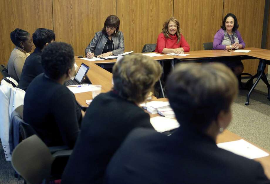 Black Women's Leadership Alliance members Frankie Clark, facing camera from left, Rosaland Guidry Anderson, and Danita Harth-Bates discuss final arrangements for DreamWeek Thursday, Jan. 11, 2018. The BWLA focuses on strengthening leadership among professional African American women. Photo: William Luther, Staff / San Antonio Express-News / © 2018 San Antonio Express-News