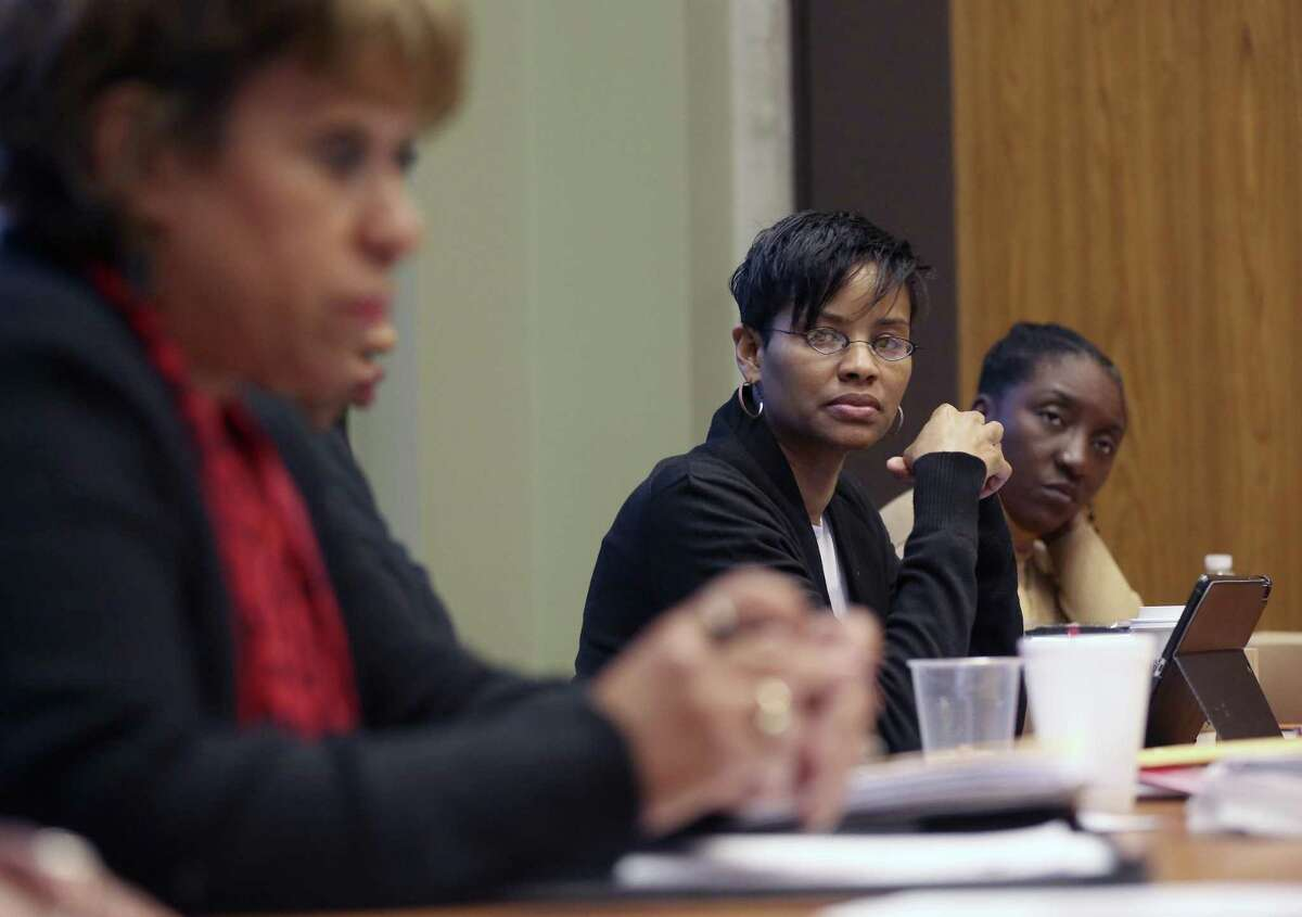 Black Women's Leadership Alliance marketing co-chair Debb Houston listens to final plans for DreamWeek activities Thursday, Jan. 11, 2018 with other members of the organization. The BWLA focuses on strengthening leadership among professional African American women.