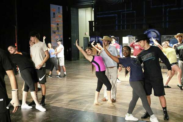 """Dancers practice for La Porte High School's production of """"Guys and Dolls,"""" which involves participation from several hundred students."""