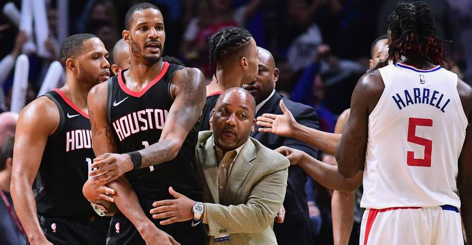Trevor Ariza of the Rockets is restrained by team staffer Bryant Savage before his ejection from Monday's loss to the Clippers in Los Angeles. Photo: Harry How/Getty Images