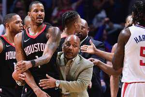 LOS ANGELES, CA - JANUARY 15:  Trevor Ariza #1 of the Houston Rockets is restrained by an assistant coach before his ejection from the game during a 113-102 LA Clippers win at Staples Center on January 15, 2018 in Los Angeles, California.  (Photo by Harry How/Getty Images)